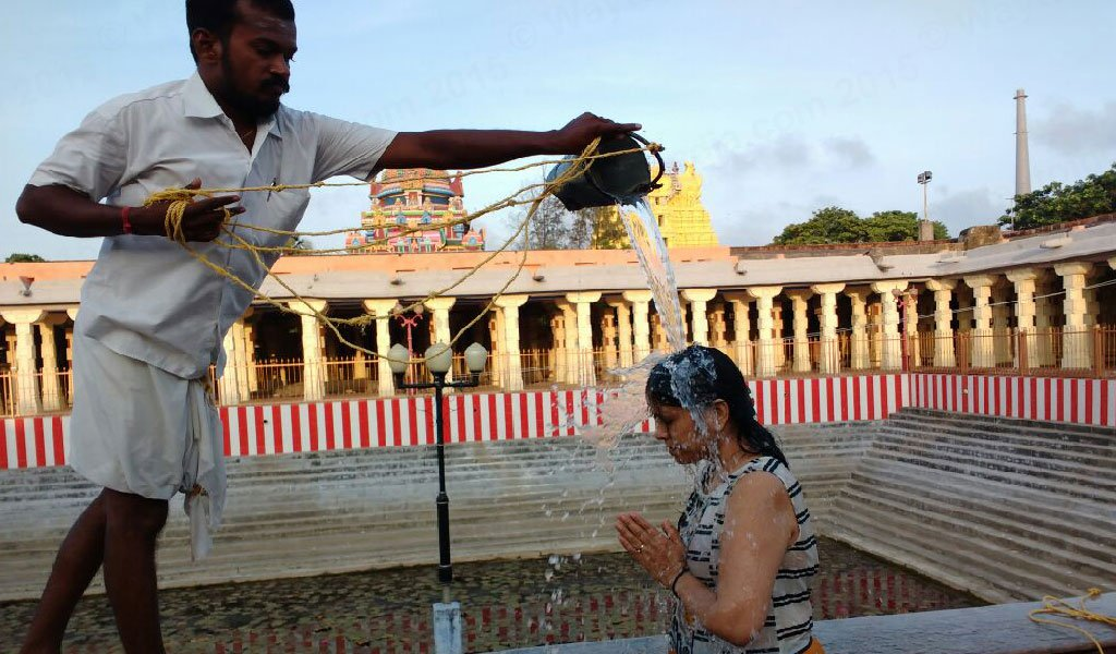 Devotees taking bath at 22 Wells in Rameshwaram Temple